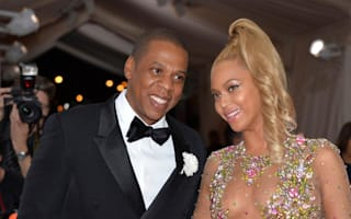 Which celebrity couple is worth over $1 billion - and why?