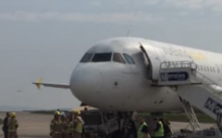 Plane collides with truck while being towed onto runway