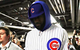LeBron rocks Cubs uniform after losing bet with Wade