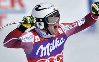 Kilde claims super-G crown as Feuz wins again