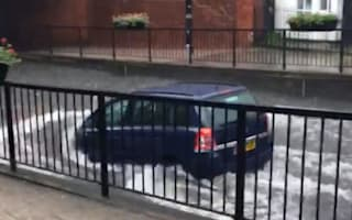 Driver misjudges floodwater depth in south London and sinks