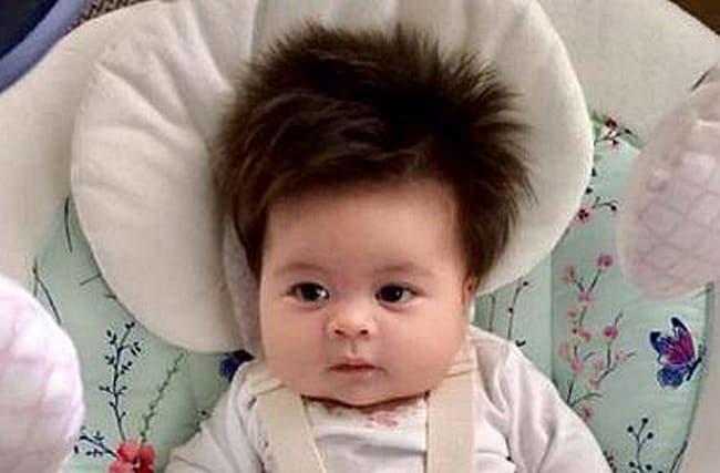 This two-month-old baby will give you serious hair envy