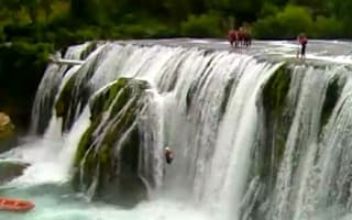Video: Thrill-seekers risk death in 80ft waterfall jump