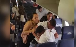 Flight attendant gets caught up in plane brawl