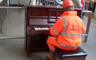 Workman wows commuters with piano skills at St Pancras