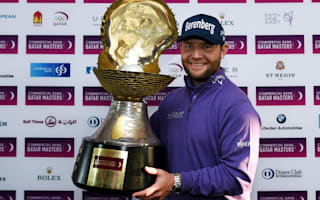 Grace defends Qatar crown following Lawrie slump