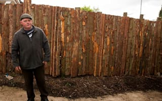 Couple must pay £600 after refusing to demolish 'ugly' fence