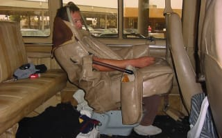 US border control release photo of man sewn into car seat