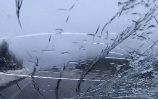 Chunk of snow breaks off truck and smashes car windscreen