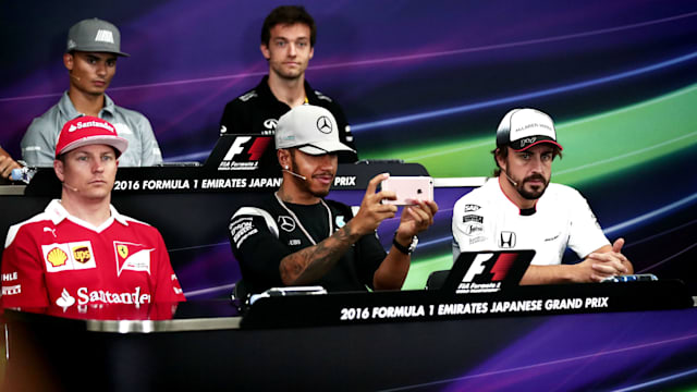 Japanese Grand Prix: Nico Rosberg beats Lewis Hamilton to take pole position