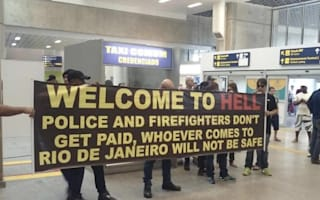 Police greet tourists with 'Welcome to hell' banner at Rio airport