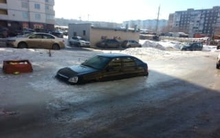 Lada on ice: man returns to car to find it frozen solid