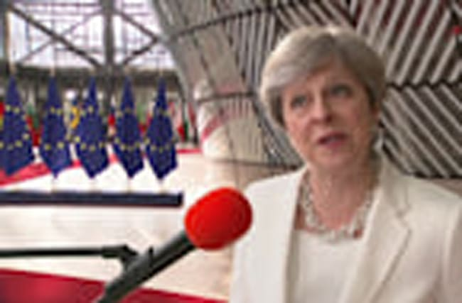 May proposes 'serious and fair' offer for EU citizens