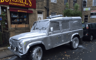 Police Land Rover spray-painted silver by vandals