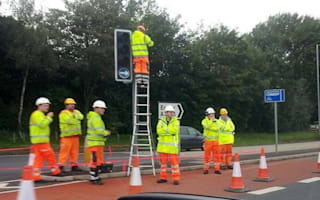 How many road workers does it take to change a light bulb?