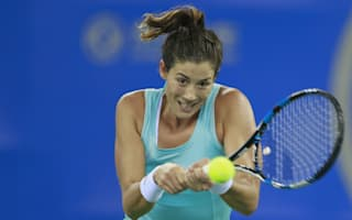 Muguruza battles back to beat Begu in Beijing