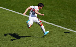 Arsenal extend Asano's Stuttgart loan