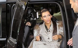 Kim Kardashian sensationally pictured inside a car...but what was she doing there?
