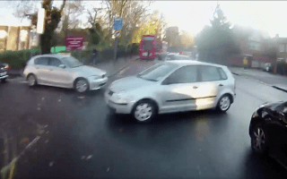 Car turns in front of speeding cyclist