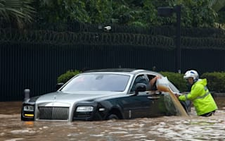Holy Roller! Flooding in Jakarta leaves unlucky Rolls Royce owner stranded