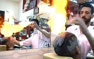 This barber uses fire to cut hair
