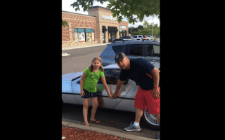 Little girl can't contain her excitement after parents buy DeLorean
