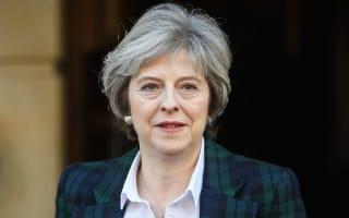Theresa May says Britain wants to keep tariff-free trade with EU