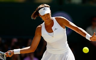 Muguruza beaten in first game since French Open win