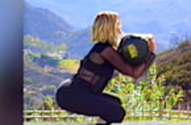 Khloe Kardashians Shows How to Get A Booty in Retro Workout Video