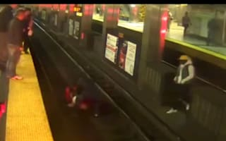 Video: Brave passengers jump on to train track to rescue injured man