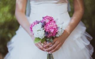 Eager woman dominates wedding bouquet toss