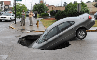 Sinkhole 'swallows' car with family of four inside (video)