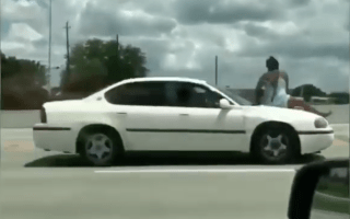 Shocking moment woman rides her own car bonnet down freeway