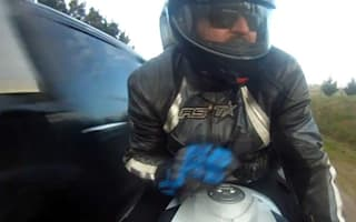 Video: Biker survives scarily close call
