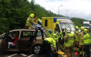 Lucky motorcyclist somersaulted on to car that he had collided with