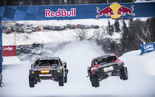 Powerful trucks take part in snow slope challenge
