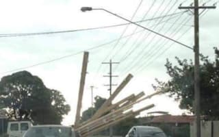 Motorist pictured with huge planks of wood sticking out of car window
