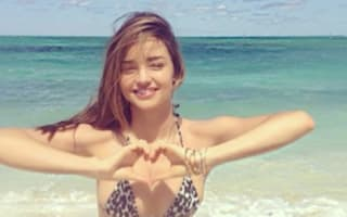 Miranda Kerr shares carefree beach bikini photos