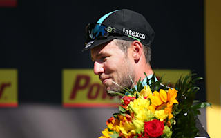 Cavendish claims first yellow jersey