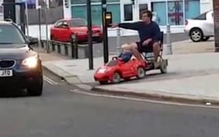 Young boy caught giving his dad a tow with electric toy car