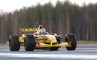 Russian PM Putin takes an F1 car for a spin