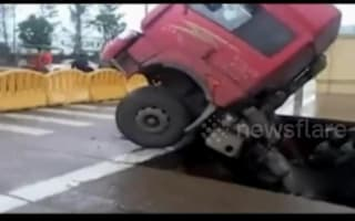 Lorry is swallowed by sinkhole on Chinese road