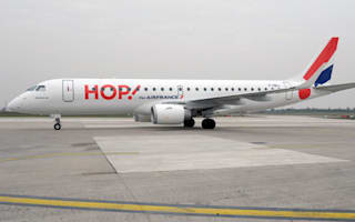 French plane quarantined after passengers develop swine flu symptoms