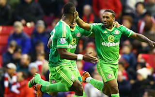 Liverpool 2 Sunderland 2: Defoe snatches a point amid Anfield protest