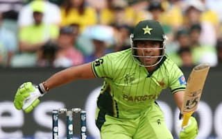 Akmal banned for clothing violation