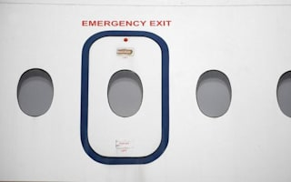 Passenger opens emergency plane door while looking for toilet
