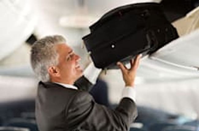 There's a correct way to put your luggage in the overhead locker