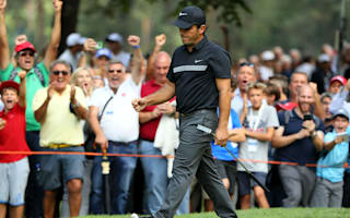 Molinari holds off Willett to make history in his homeland