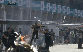 Formula 1 star forced to flee burning race car