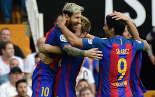 Valencia 2 Barcelona 3: Messi penalty snatches win but champions fret over Iniesta injury